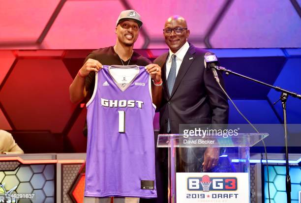 Jamario Moon poses with BIG3 Commissioner Clyde Drexler after being drafted at by the Ghost Ballers in the first round during the BIG3 Draft at the...