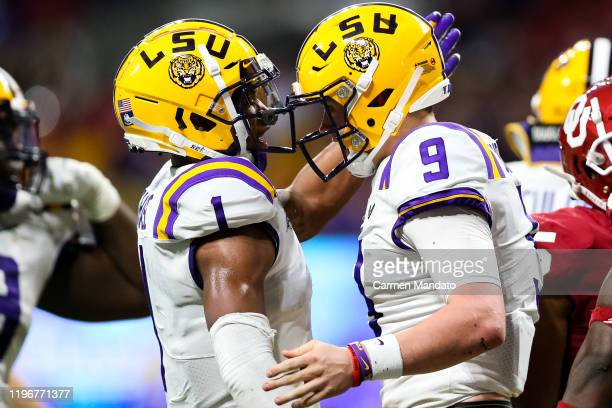 Ja'Marr Chase celebrates alongside Joe Burrow of the LSU Tigers during the ChickfilA Peach Bowl against the Oklahoma Sooners at MercedesBenz Stadium...