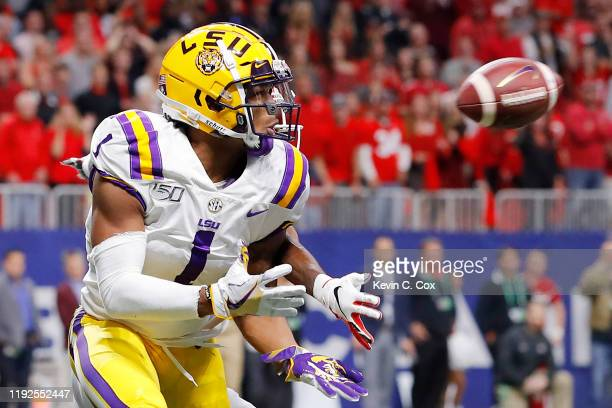 Ja'Marr Chase of the LSU Tigers catches a touchdown pass in the first quarter against the Georgia Bulldogs during the SEC Championship game at...