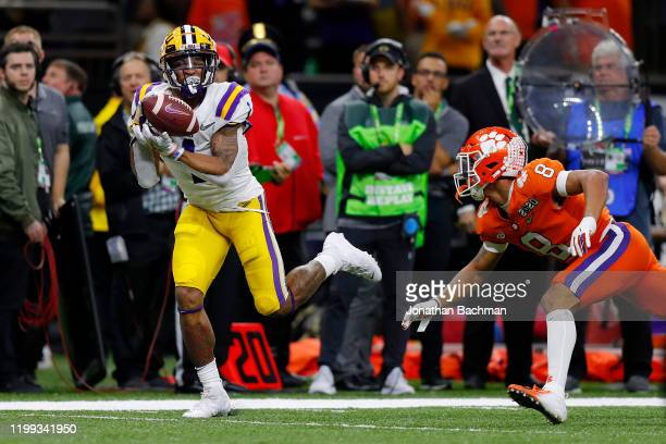 Ja'Marr Chase of the LSU Tigers catches the ball for a 52 yard touchdown against the Clemson Tigers in the College Football Playoff National...
