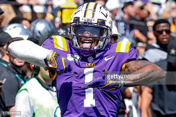 Ja'Marr Chase of the LSU Tigers celebrates after making a reception against the Vanderbilt Commodores during the first half at Vanderbilt Stadium on...