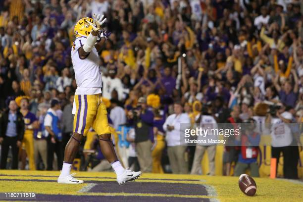Ja'Marr Chase of the LSU Tigers celebrates his touchdown against the Florida Gators in the first quarter at Tiger Stadium on October 12 2019 in Baton...