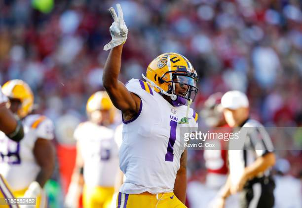 Ja'Marr Chase of the LSU Tigers celebrates scoring a 33yard receiving touchdown during the first quarter against the Alabama Crimson Tide in the game...