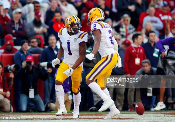 Ja'Marr Chase of the LSU Tigers celebrates with Justin Jefferson after scoring a 33yard receiving touchdown during the first quarter against the...