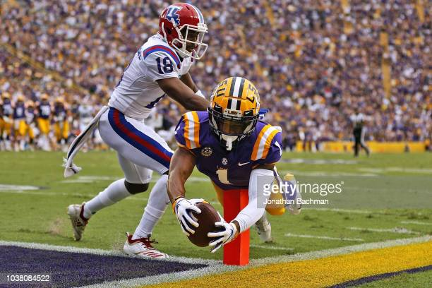 Ja'Marr Chase of the LSU Tigers dives for a touchdown as Zach Hannibal of the Louisiana Tech Bulldogs defend during the first half at Tiger Stadium...