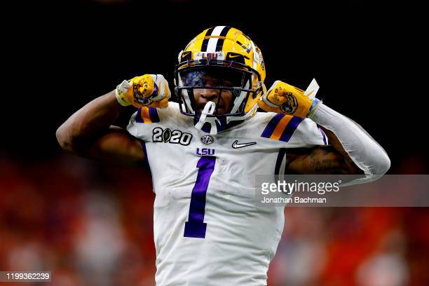 Ja'Marr Chase of the LSU Tigers reacts after a catch against the Clemson Tigers in the College Football Playoff National Championship game at...