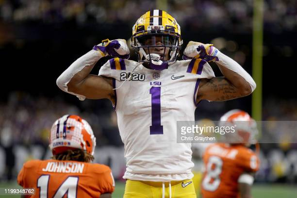 Ja'Marr Chase of the LSU Tigers reacts to a touchdown during the first half against the Clemson Tigers in the College Football Playoff National...