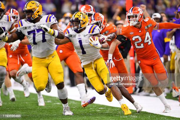 Ja'Marr Chase of the LSU Tigers runs for a first down against the Clemson Tigers during the College Football Playoff National Championship held at...