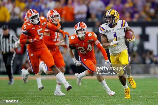 Ja'Marr Chase of the LSU Tigers runs the ball against the Clemson Tigers in the College Football Playoff National Championship game at Mercedes Benz...