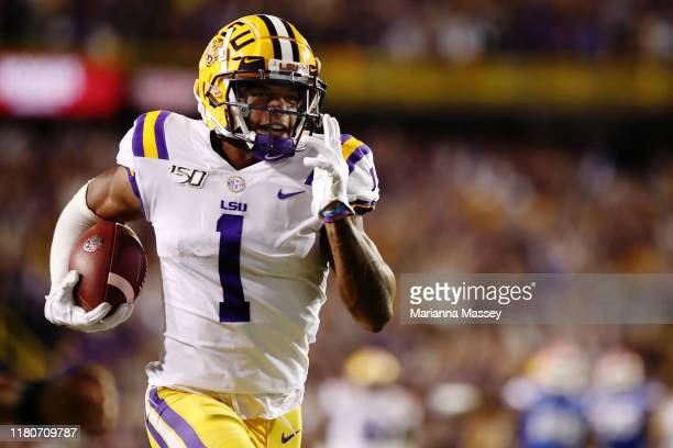 Ja'Marr Chase of the LSU Tigers runs the ball in for a touchdown against the Florida Gators at Tiger Stadium on October 12 2019 in Baton Rouge...