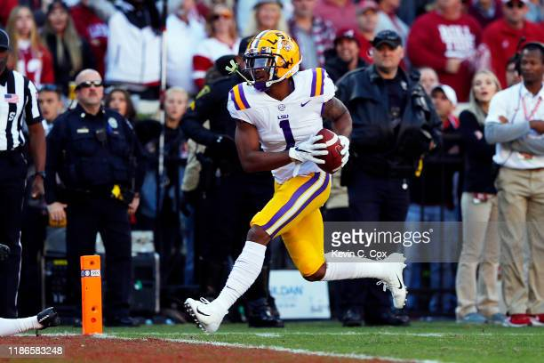 Ja'Marr Chase of the LSU Tigers scores a 33yard receiving touchdown during the first quarter against the Alabama Crimson Tide in the game at...