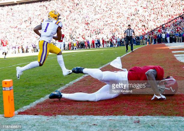 Ja'Marr Chase of the LSU Tigers scores a touchdown as Trevon Diggs of the Alabama Crimson Tide falls down during the first half at BryantDenny...