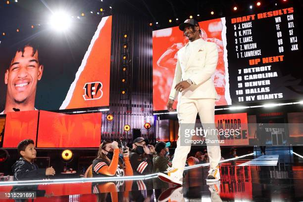 Ja'Marr Chase walks onstage after being selected fifth by the Cincinnati Bengals during round one of the 2021 NFL Draft at the Great Lakes Science...