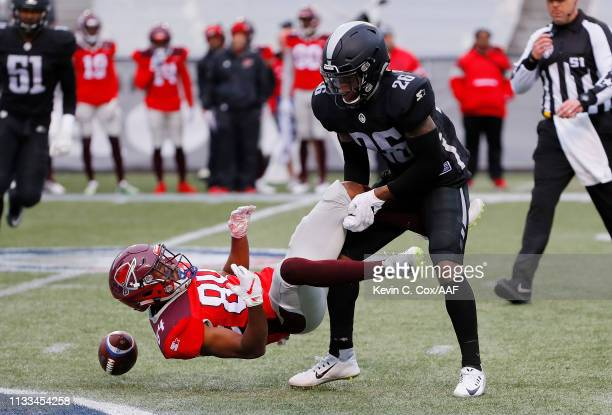 Jamar Summers of the Birmingham Iron tackles Greg Ward Jr #84 of the San Antonio Commanders during the first half in an Alliance of American Football...