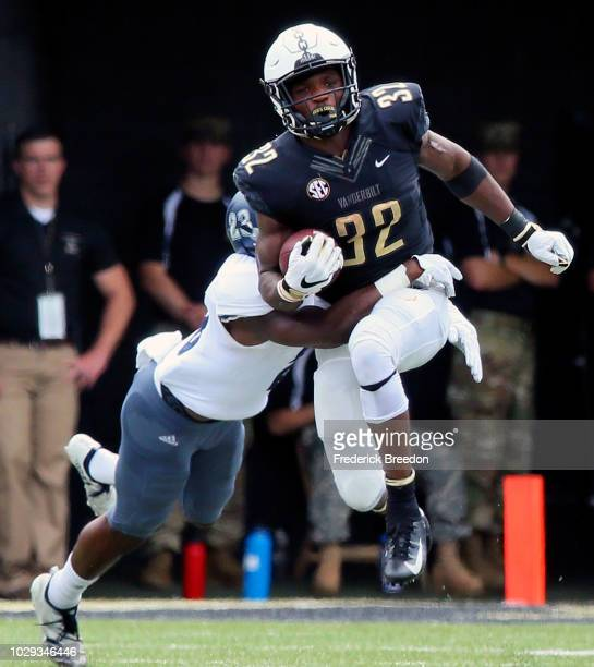 Jamauri Wakefield of the Vanderbilt Commodores is tackled by Jomon Dotson of the Nevada Wolf Pack during the first half at Vanderbilt Stadium on...