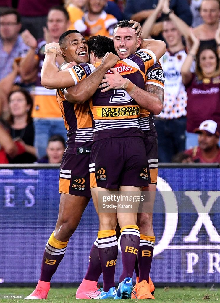 Jamayne Isaako, James Roberts and Darius Boyd of the Broncos celebrate victory after the round two NRL match between the Brisbane Broncos and the North Queensland Cowboys at Suncorp Stadium on March 16, 2018 in Brisbane, Australia.
