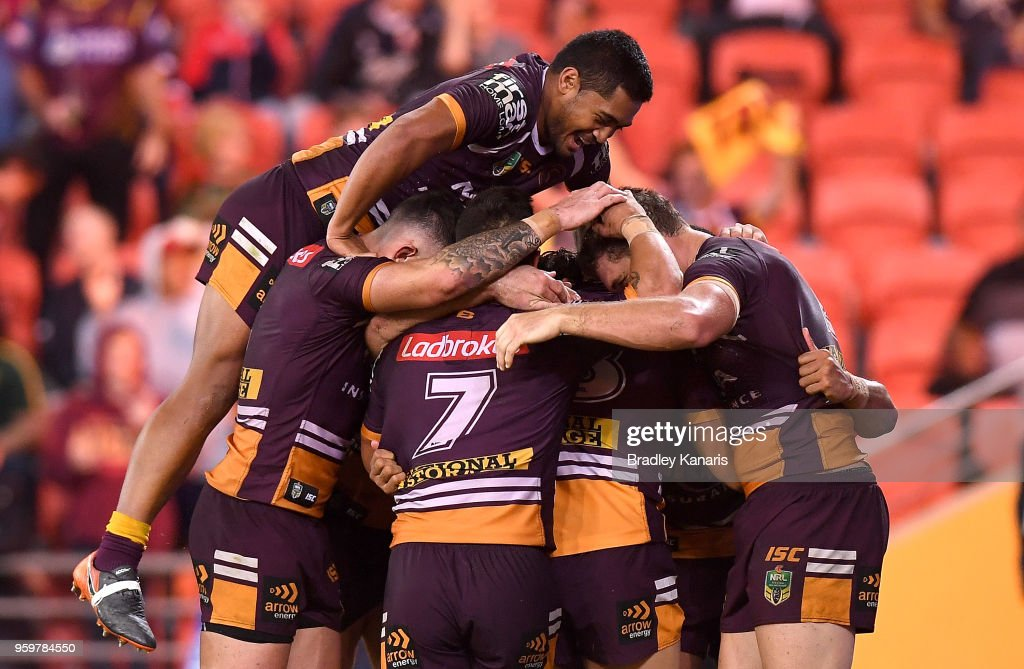Jamayne Isaako of the Broncos is congratulated by team mates after scoring a try during the round 11 NRL match between the Brisbane Broncos and the Sydney Roosters at Suncorp Stadium on May 18, 2018 in Brisbane, Australia.