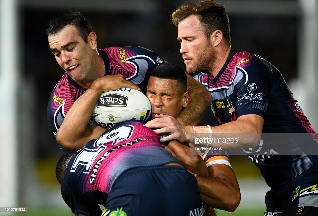 Jamayne Isaako of the Broncos is tackled by Gideon Gela-Mosby, Gavin Cooper and Kane Linnett of the Cowboys during the round 22 NRL match between the North Queensland Cowboys and the Brisbane Broncos at 1300SMILES Stadium on August 9, 2018 in Townsville, Australia.