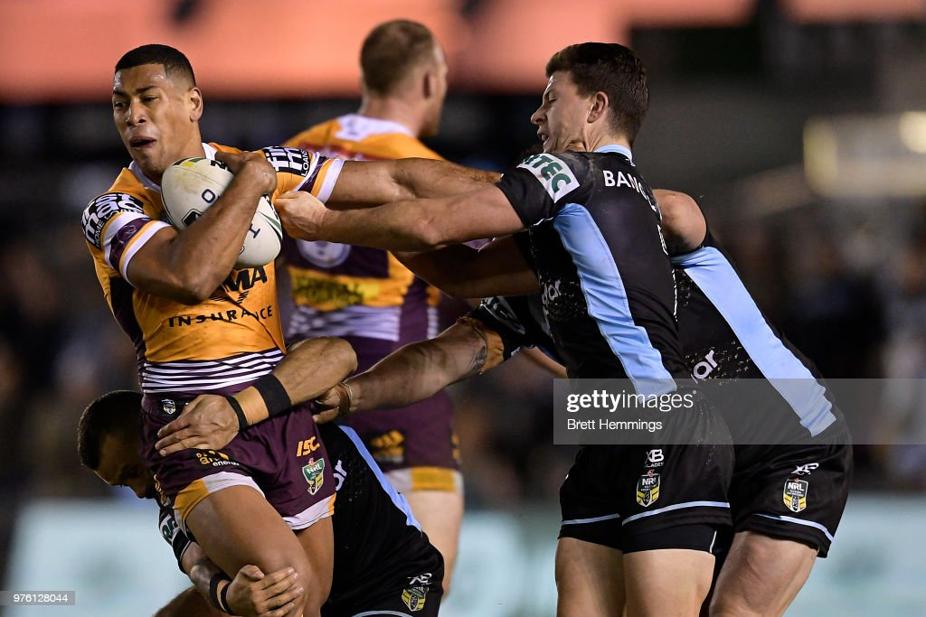 Jamayne Isaako of the Broncos is tackled during the round 15 NRL match between the Cronulla Sharks and the Brisbane Broncos at Southern Cross Group Stadium on June 16, 2018 in Sydney, Australia.
