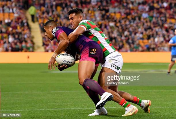 Jamayne Isaako of the Broncos is tackled during the round 23 NRL match between the Brisbane Broncos and the South Sydney Rabbitohs at Suncorp Stadium...