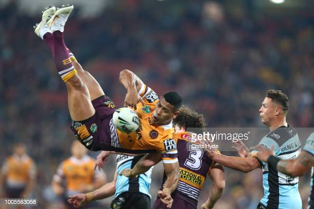 Jamayne Isaako of the Broncos is tackled in the air during the round 20 NRL match between the Brisbane Broncos and the Cronulla Sharks at Suncorp...