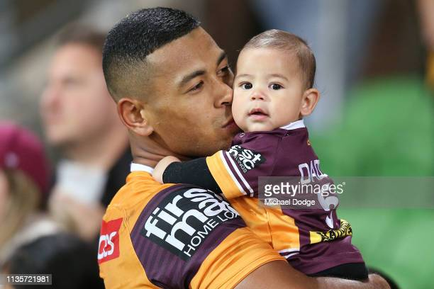 Jamayne Isaako of the Broncos with his child after defeat during the round one NRL match between the Melbourne Storm and the Brisbane Broncos at AAMI...