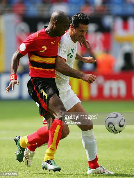 Jamba of Angola tangles with Ali Daei of Iran during the FIFA World Cup Germany 2006 Group D match between Iran and Angola played at the...