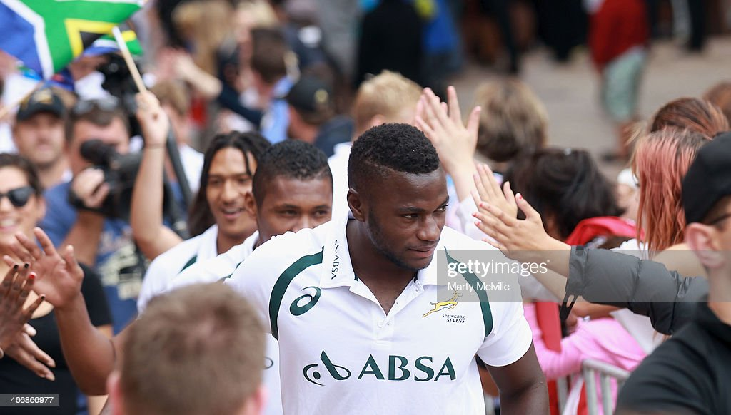 Jamba Ulengo walks through the crowds in Civic Square during a South African street parade ahead of the 2014 Wellington Sevens on February 5, 2014 in Wellington, New Zealand.
