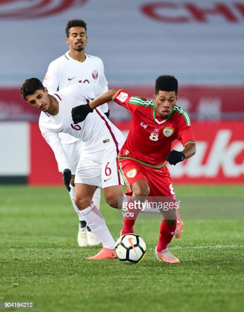 Jameel Al Yahmadi of Oman and Abdullah Al Ahrak of Qatar compete for the ball during the AFC U23 Championship Group A match between Oman and Qatar at...