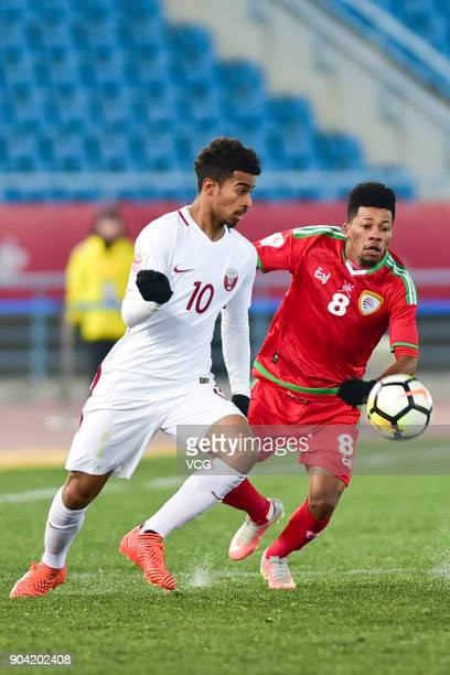 Jameel Al Yahmadi of Oman and Akram Afif of Qatar compete for the ball during the AFC U23 Championship Group A match between Oman and Qatar at...