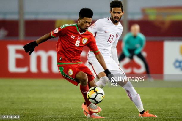 Jameel Al Yahmadi of Oman and Sultan Al Brake of Qatar compete for the ball during the AFC U23 Championship Group A match between Oman and Qatar at...