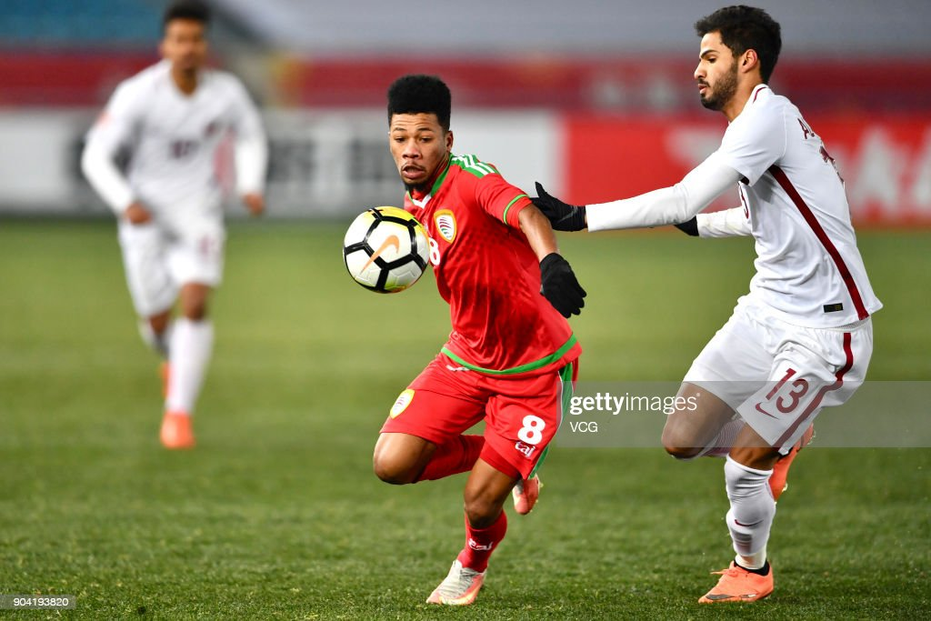 Jameel Al Yahmadi #8 of Oman and Sultan Al Brake #13 of Qatar compete for the ball during the AFC U-23 Championship Group A match between Oman and Qatar at Changzhou Olympic Sports Center on January 12, 2018 in Changzhou, Jiangsu Province of China.