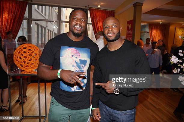Jameel McClain and Mike Adams attend the Draft Classic Schuyler Gifting Suite at Gilded Lily on May 6 2014 in New York City