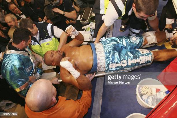 Jameel McCline is stretchered from the boxing hall with an injured knee during the WBA World Heavyweight Championship fight between Nikolay Valuev of...