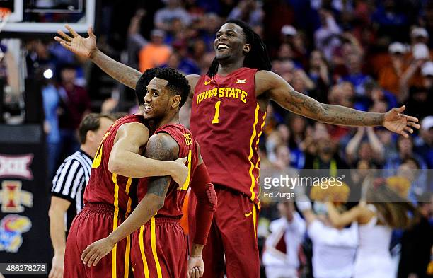 Jameel McKay Monte Morris and Dustin Hogue of the Iowa State Cyclones celebrate their 70 to 66 win over the Kansas Jayhawks during the championship...
