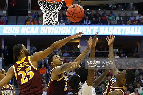 Jameel McKay of the Iowa State Cyclones and Jordan Washington of the Iona Gaels fight for a rebound during the first round of the 2016 NCAA Men's...
