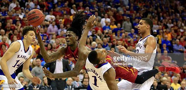 Jameel McKay of the Iowa State Cyclones drives toward the basket as Wayne Selden Jr. #1, Brannen Greene and Landen Lucas of the Kansas Jayhawks...
