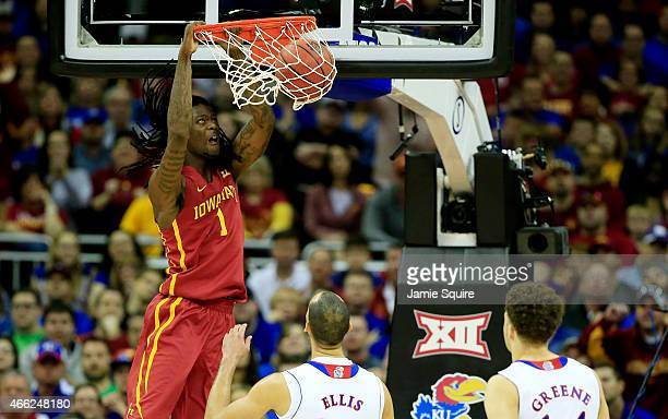 Jameel McKay of the Iowa State Cyclones dunks as Perry Ellis and Brannen Greene of the Kansas Jayhawks look on in the first half during the...