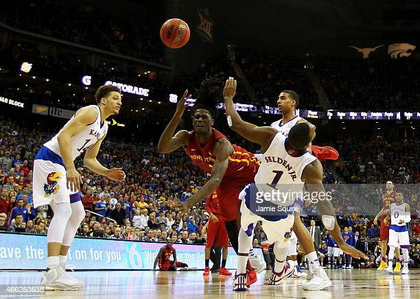Jameel McKay of the Iowa State Cyclones goes up against Wayne Selden Jr. #1 of the Kansas Jayhawks in the second half during the championship game of...