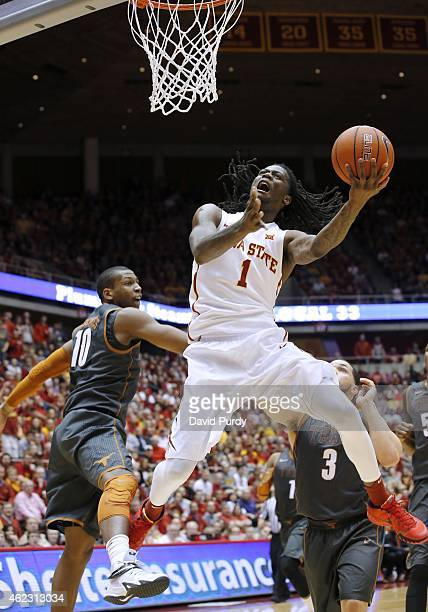 Jameel McKay of the Iowa State Cyclones lays up a shot as Jonathan Holmes of the Texas Longhorns blocks in the first half of play at Hilton Coliseum...