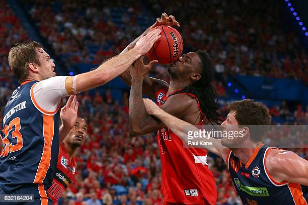 Jameel McKay of the Wildcats gets fouled going to the basket against Mark Worthington and Cameron Gliddon of the Taipans during the round 16 NBL...