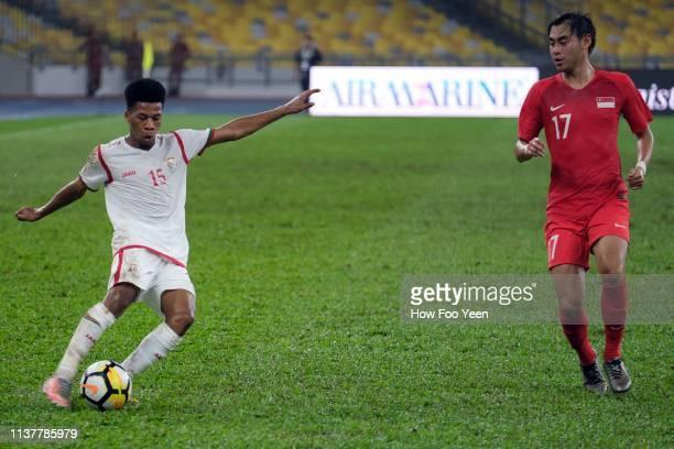 Jameel Saleem Jameel in action with Gabriel Quak Jun Yi of Singapore during the Airmarine Cup final between Singapore and Oman at Bukit Jalil...