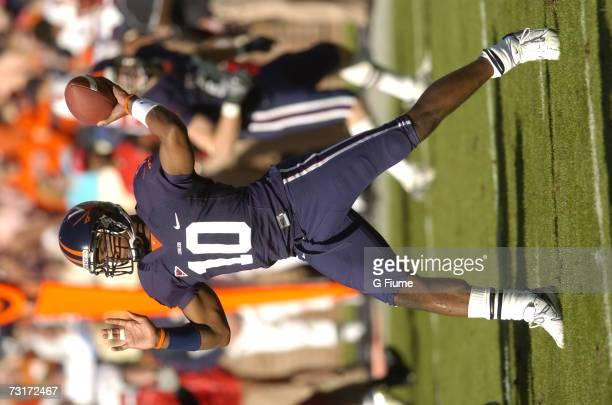 Jameel Sewell of the Virginia Cavaliers throws a pass against the Maryland Terrapins October 14 2006 at the Carl Smith Center in Charlottesville...