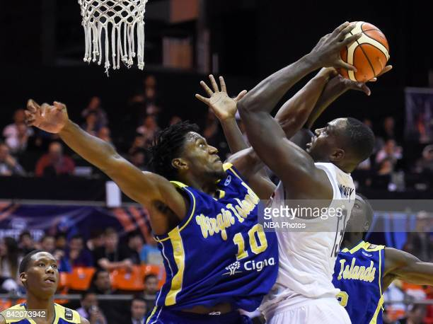 Jameel Warney of United States fights for ball with Jahmia Simmons of Virgin Islands during the FIBA Americup semi final match between US and Virgin...