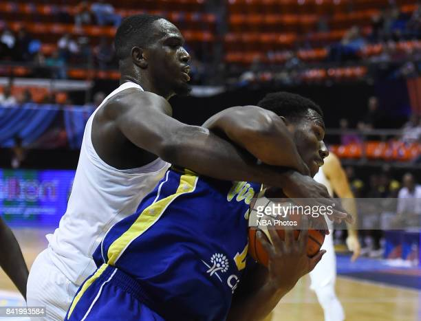Jameel Warney of United States fights for the ball with Javier Martinez of Virgin Island during the FIBA Americup semi final match between US and...
