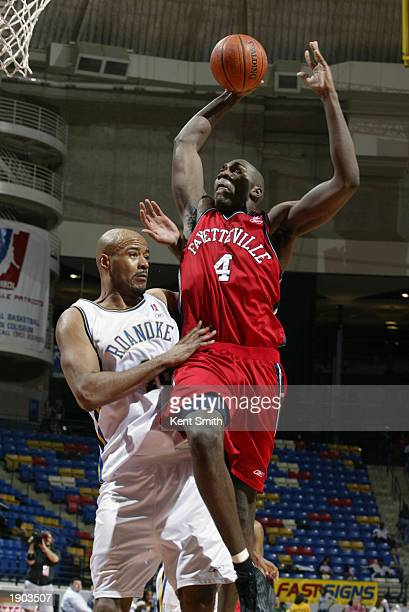 Jameel Watkins of the Fayetteville Patriots goes to the hoop past Darrell Johns of the Roanoke Dazzle during Game One of the NBDL Semifinals at the...