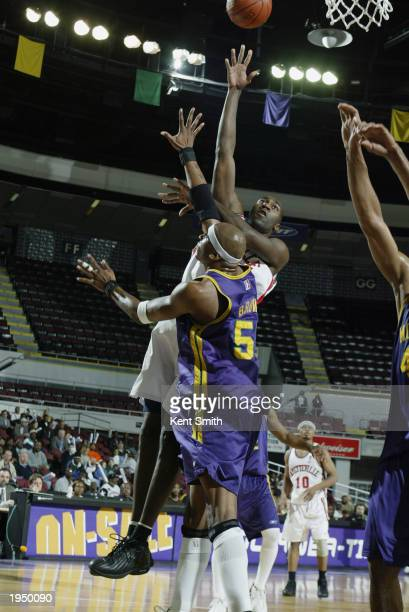 Jameel Watkins of the Fayetteville Patriots shoots over Ernest Brown of the Mobile Revelers during Game two of the NBDL Finals at Mobile Civic Center...