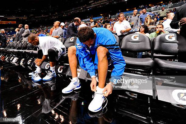 Jameer Nelson left and Hedo Turkoglu of the Orlando Magic put on their sneakers before facing the Philadelphia 76ers during a preseason game on...
