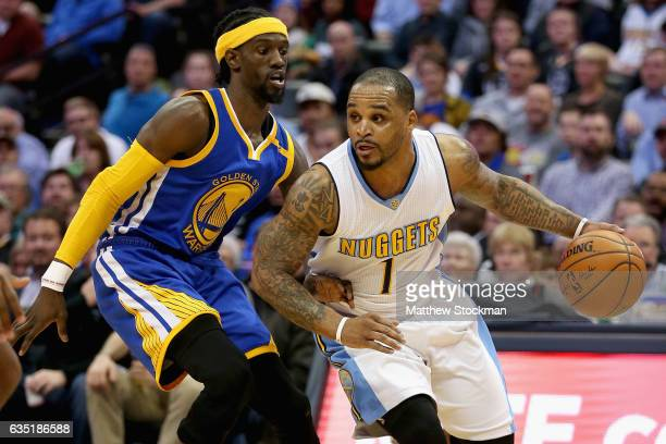 Jameer Nelson of the Denver Nuggets drives against Briante Weber of the Golden State Warriors at the Pepsi Center on February 13 2017 in Denver...