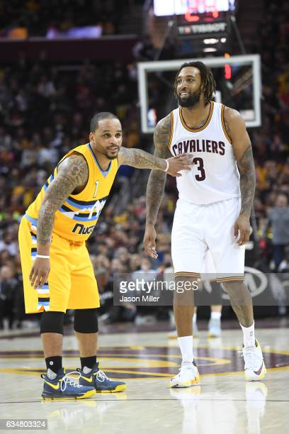 Jameer Nelson of the Denver Nuggets guards Derrick Williams of the Cleveland Cavaliers during the second half at Quicken Loans Arena on February 11...